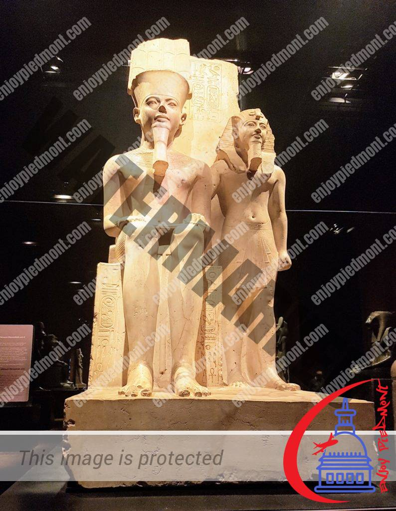 Statue of the pharaoh Horemheb with the god Amun - Egyptian Museum - Turin