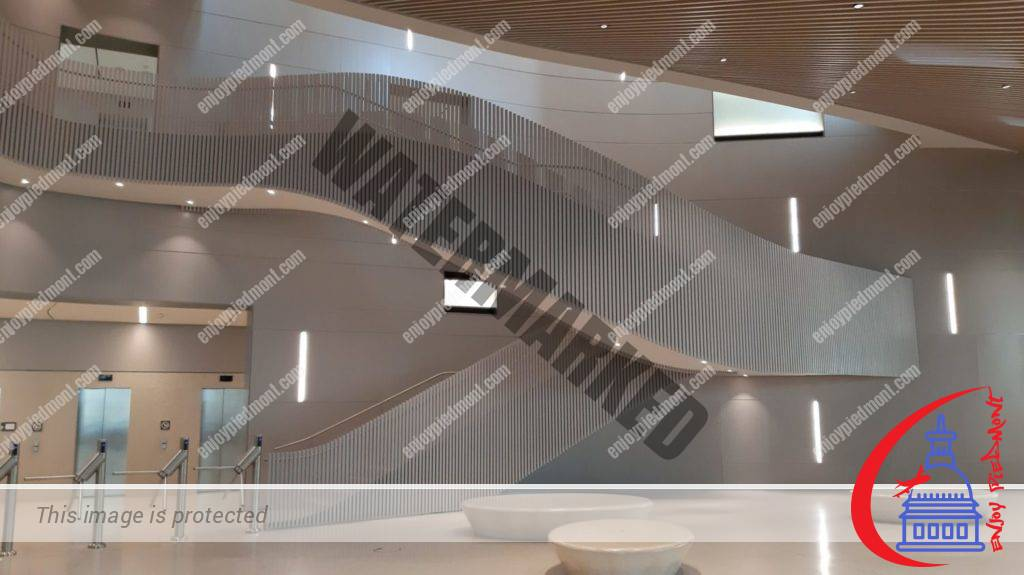 Main staircase with a fluid flow in the glass atrium - Nuvola Lavazza